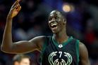 Milwaukee Bucks forward Thon Maker smiles after hitting a three-point shot against the Chicago Bulls. Photo/AP Photos