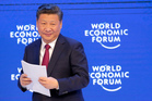 China's President Xi Jinping smiles to the audience after his speech at the World Economic Forum in Davos, Switzerland. Photo / AP