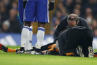 Hull City's Ryan Mason is treated by medics after a header with Chelsea's Gary Cahill during their English Premier League soccer match. Photo/AP Photos
