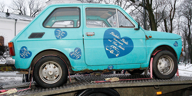 In Suwalki, Poland, a Fiat 126p that fans have bought for actor Tom Hanks as a souvenir, sits on a trailer ready for delivery. Photo / AP