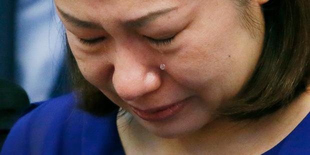 Choi Kyung-jin, the widow of South Korean businessman Jee Ick-joo, who was kidnapped and later killed by his abductors, cries at the start of the Philippine Senate probe in the killing. Photo / AP