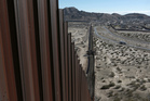 President Trump plans to build an enormous wall along the 3218km border between the US and Mexico. Photo / AP
