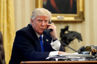 President Donald Trump speaks on the phone with Prime Minister of Australia Malcolm Turnbull in the Oval Office of the White House. Photo / AP