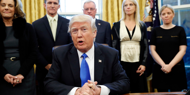 President Donald Trump speaks after signing an order banning visitors from seven majority-Muslim nations on Saturday. Photo / AP