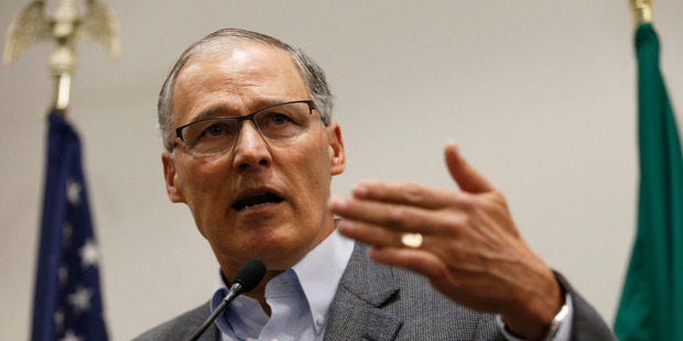 """Washington Governor Jay Inslee blasted President Donald Trump's executive order banning people from certain Muslim-majority nations as """"unjustifiable cruelty"""". Photo / AP"""