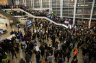 More than 1,000 people gathered at Seattle-Tacoma International Airport, to protest President Donald Trump's order that restricts immigration to the US in Seattle. Photo / AP