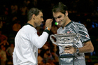 Roger Federer, right, holds his trophy after defeating Rafael Nadal, left, during their men's singles final at the Australian Open tennis championships in Melbourne. Photo / AP