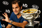 Switzerland's Roger Federer gestures as he answers questions at a press conference after defeating Spain's Rafael Nadal in the men's singles final. Photo / AP.