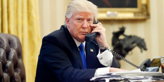 Loading U.S. President Donald Trump speaks on the phone with Prime Minister of Australia Malcolm Turnbull in the Oval Office of the White House in Washington. Photo / AP
