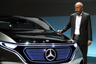CEO of the Daimler AG Dieter Zetsche poses for photographers at the company's headquarters in Stuttgart, Germany. Photo / AP