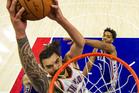 Oklahoma City Thunder's Steven Adams goes up for the dunk against Philadelphia 76ers. Photo/AP Photos
