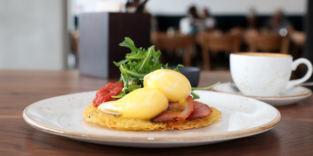 The eggs benedict on agria rosti with bacon, rocket and smoked tomato relish. Photo / Getty Images