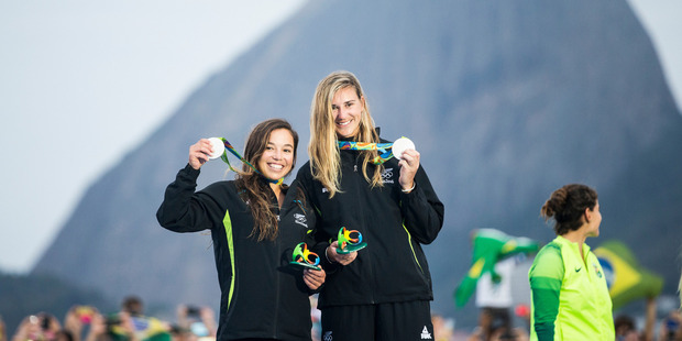 Alex Maloney and Molly Meech of New Zealand on the podium after winning silver in the Womens 49erFX class. Photo / Sailing Energy / World Sailing