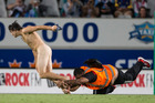 A streaker is caught by security staff during the opening match of Super Rugby season between the Blues and the Highlanders at Eden Park. Photo / Jason Oxenham.