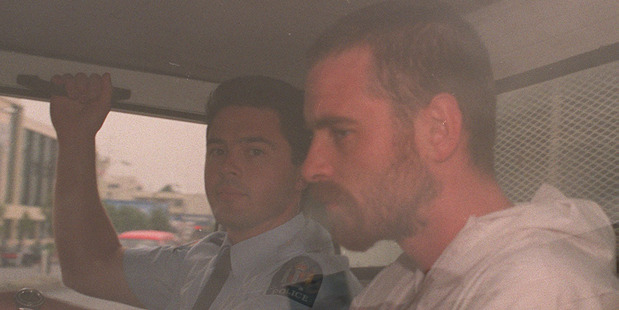 Raurimu killer Stephen Anderson is driven from the Hamilton District Court in a police van. NZ Herald file photograph.