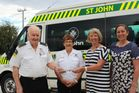 John Ross, left, June Elmore, both volunteers with the St John Health Service, receive a cheque for $2400 from Sue Buchanan and Liz Parkes.
