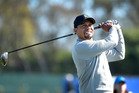 Tiger Woods plays a tee shot during the Pro-Am round for the Farmers Insurance Open at Torrey Pines Golf Course. Photo/AP Photos