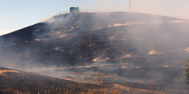 Loading SCORCHED EARTH: Crews from across Hawke's Bay battled a 20ha Puketapu fire yesterday. PHOTO/PAUL TAYLOR.