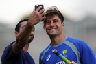 WAY TO GO: Hawke's Bay cricketer Harry Ghodke grabs a selfie with Aussie allrounder Marcus Stoinis in Napier yesterday. PHOTO/Paul Taylor