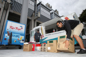 GEARING UP: Ngapaki Gripp (left) and Sherif Riad from Baxters Event Catering loading up the caravans with supplies ready for today's big game. PHOTO/DUNCAN BROWN.