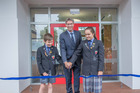 St George's headmaster Andrew Osmond cuts the ribbon to the new campus, along with head boy Elliott Jones and head girl Sami Harrison. PHOTO/SUPPLIED