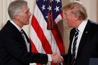 Neil Gorsuch is congratulated by Donald Trump after the President nominated him for the Supreme Court yesterday. Photo / AP