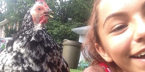 Charlotte, pictured on Facebook, with one of her chickens she had as pets.