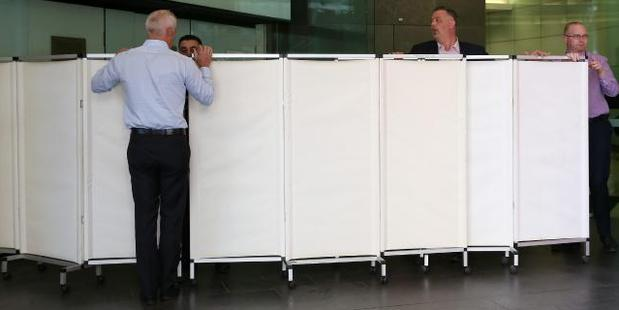 Westfield staff screen off a section of the mammoth Bondi Junction shopping centre after Bernard Gore's badly decomposed body is found in the stairwell. Photo / News Corp Australia