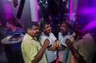 Customers wait in line outside an iZenica store prior to a midnight launch event for the Apple iPhone in New Delhi, India. Photo / Bloomberg