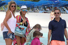 Jeremy Kyle (right) was pictured on a beach in Barbados in 2013 with his former nanny Vicky Burton (far left) and his ex-wife Carla Germaine (second left). Photo / Splash News Australia