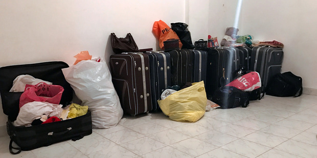 Luggage belonging to the family rests in their empty apartment on the outskirts of Cairo, Egypt. Photo / The Washington Post.
