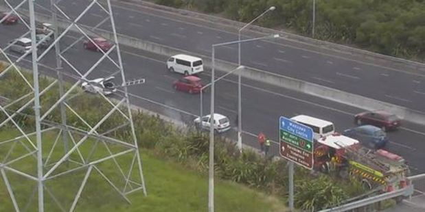 Motorists are being urged to drive carefully on the south-bound lanes of the Southern Motorway near Redoubt Rd as firefighters  attend to a small scrub fire on the side of the motorway. Photo / NZTA