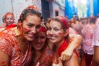 People in La Tomatina festival. Photo / Getty Images