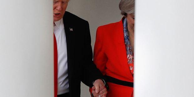 Loading Donald Trump and Theresa May hold hands. Photo / AP
