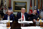 President Donald Trump, flanked by Commerce Secretary-designate Wilbur Ross, left, and Harley Davidson President and CEO Matt Levatich. Photo / AP