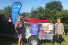 (From left) Rotary Rotorua Sunrise Club member Lynne Joseph and the club's community director Rachel Warrender, with Leslie Patchell and the trailer of goods. Photo/Supplied
