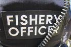 The fishery officer was allegedly threatened with a bait knife. Photo/File
