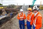 Peter Gubb, of Refining NZ, Whangarei MP Shane Reti and Refining NZ CEO Sjoerd Post at the pipeline repair site at Ruakaka in September. Photo / Michael Cunningham