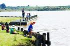Ngahinapouri School students stake out their preferred fishing spots in the quest for the biggest haul of pest fish from Lake Ngaroto.