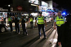 Police block Marsden Rd after a brawl which started in Paihia Mall during last year's New Year's Eve festivities  spilled onto the town's main street. Photo / Peter de Graaf