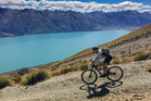 Michael Brown makes his way through the southern country side during the 10 hour journey over 106 km of hilly stage four from Lake Tekapo to Lake Ohau. Photo / Greg Bowker