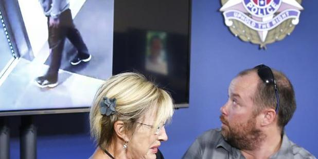 Loading Victim David Dick's brother Simon Dick and mother Carol Cloke sit in front of an image of the suspect - who they didn't recognise as family member Jonathan Dick. Photo / News Corp Australia