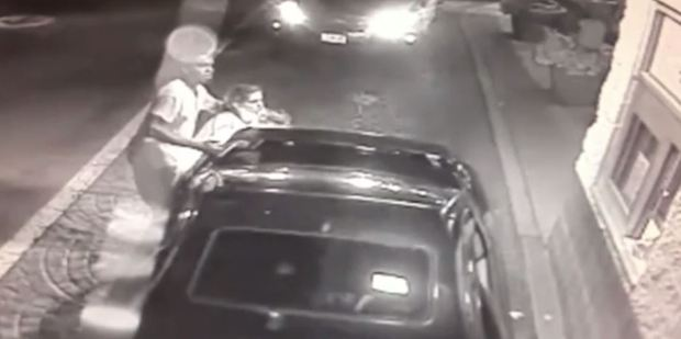 Jessica Wilson was seen on surveillance video rushing out of a car (left) holding her two-year-old daughter in the drive-thru of a McDonald's in Cincinnati. Photo / McDonald's CCTV