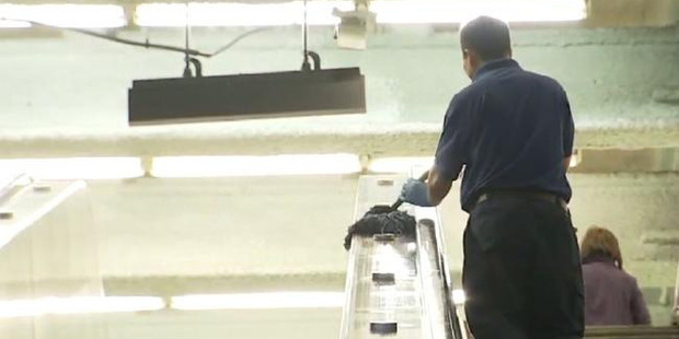 Security footage shows Mr Zhang sweeping, mopping and, allegedly, slacking off. Photo / KTVU