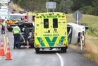 Emergency services at the scene of a crash on State Highway 30. PHOTO/BEN FRASER