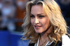 Madonna has been given the okay to adopt twin Malawi girls. Photo/AP