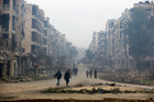 Residents walk through the destruction in the once rebel-held Salaheddine neighbourhood of eastern Aleppo, Syria. Photo / AP