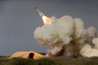 A long-range S-200 missile is fired in a military drill in the port city of Bushehr, Iran, last year. Photo / AP file
