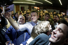 Russian opposition leader Alexei Navalny takes a selfie with his supporters in St Petersburg, Russia. Photo / AP