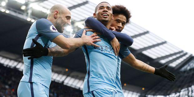 Manchester City's Gabriel Jesus celebrates scoring his second goal against Swansea City. Photo / AP